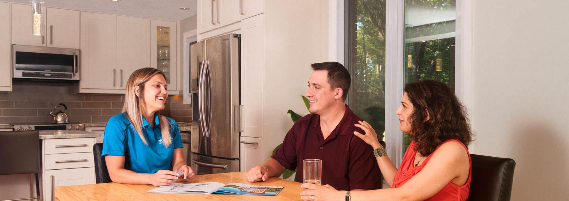 A Nordik representative answers questions during a free in-home window and door consultation.