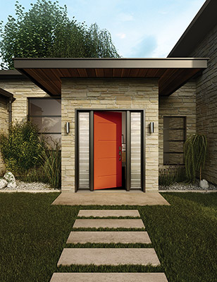 An oversized red front door on a modern home