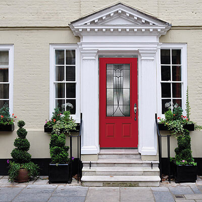 A colonial red residential door