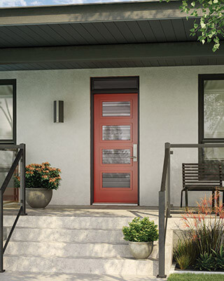 A bold red front door with four glass inserts