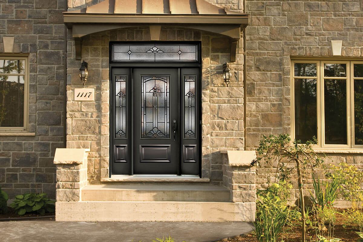 A front entry door with sidelites, an insert and a transom.